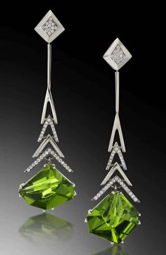 A modern earring design by Adam Neeley. Crescendo Peridot Earrings feature two stunning peridot, cut by lapidary artist Tom Munsteiner, suspended from white gold forms, accented by diamonds. Beach Jewelry, Jewelry Art, Gold Jewelry, Fine Jewelry, Cheap Jewelry, Gold Necklace, Fantasy Jewelry, Diamond Jewelry, Jewlery
