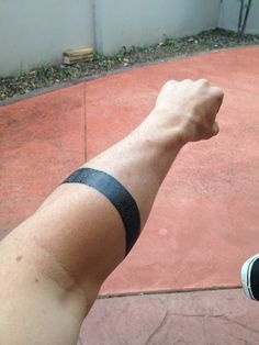 solid black   forearm band tattoo