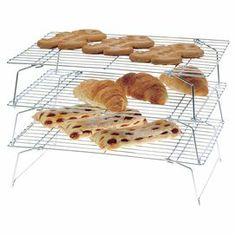 """3-tier steel cooling rack.    Product: Cooling rack Construction Material: Steel Color: Chrome Features: Three tiers Dimensions: 10"""" H x 14"""" W (overall)Cleaning and Care: Hand wash"""