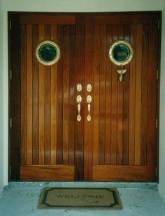 Mahogany and brass portholes