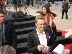 Tom Felton (with girlfriend Jade in the background) Deathly Hallows Part 2, Tom Felton, Girlfriends, Jade, Toms, Harry Potter, Nyc, New York City, Girls