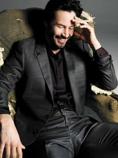 Keanu Reeves (smiling for once)