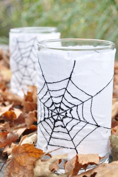 Halloween Spiderweb Votives - Create the spiderweb design using a sewing machine. These votives look great on a table during a Halloween party. From Improv Diary.