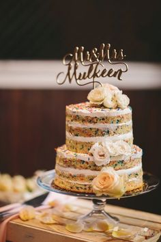 Laser cut topper and funfetti naked wedding cake: http://www.stylemepretty.com/maryland-weddings/baltimore/2015/11/24/romantic-evergreen-museum-and-library-wedding/ | Photography: Readyluck - http://www.readyluck.com/