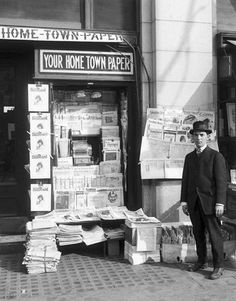 This photo shows a newspaper vendor standing by his paper stand outside the Walker Bank Building. Courtesy Utah State Historical Society