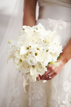 elegant white bridal bouquet of roses, stephanotis blossoms, mini calla lilies