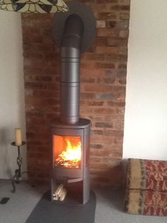 A Contura 810:1 stove in grey with a Poujoulat twin wall flue system painted grey to match the wood burner