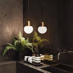 Zen in a cloakroom. a soothing golden glow in a dark tranquil space, and just in case it's not calm enough throw in some Aesop products… Grey Bathroom Tiles, Dark Bathrooms, Bathroom Cladding, Beautiful Bathrooms, Interior Design Examples, Bad Styling, Downstairs Toilet, Bathroom Styling, Bathroom Inspiration
