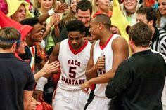 GAC seniors Collin Swinton (5) and Andrew Lewis (43) celebrate their victory over Manchester with the student section after Wednesday night's quarterfinals of the Class AA state playoffs at GAC.