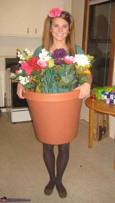 Pick up a plastic flower pot and some fake flowers from the dollar store for this potted plant look.