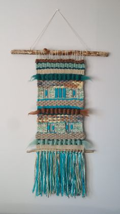 Hand made woven wall hanging tapestry. Made with natural wool, roving wool, cotton and wood, Dimensions: Length: inch) including fringe. Width: inch) Large wood piece: inch) Small wood piece: inch) It can be made to order. Ask for international shipping Weaving Textiles, Weaving Art, Tapestry Weaving, Tapestry Wall Hanging, Hand Weaving, Handloom Weaving, Roving Wool, Weaving Wall Hanging, Textile Fiber Art