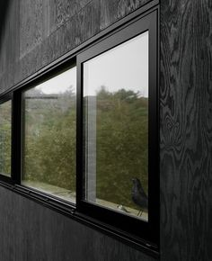 HOUSE MORRAN by Johannes Norlander Arkitektur. The new facade is cladded in plywood, coated in black pine tar just like the traditional way of preserving wooden boats. The roof is coated in simple tar paper and has thin plywood eaves with integrated alum Plywood House, Plywood Siding, Plywood Walls, House Cladding, Timber Cladding, Exterior Cladding, Exterior Trim, Black Exterior, Chalet Modern