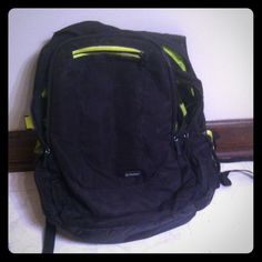 Outdoors backpack It is green and black and has many pockets Bags Backpacks