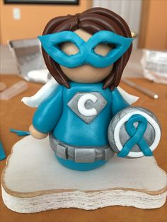 I fight cancer...What's your superpower? Ovarian cancer Superhero Christmas ornament made out of polymer clay.