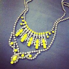 Vintage rhinestone necklaces + neon nail polish