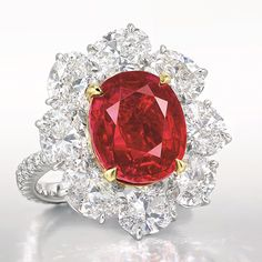 """The Magnificent Jewels sale on Nov. 29 at Christie's Hong Kong will lead with a stunning ct. Burmese pigeon's-blood ruby ring. The ring, designed by Faidee, is called the Ratnaraj Ruby; Ratnaraj means """"king of precious stones"""" in ancient Sanskrit. Red Jewelry, Fall Jewelry, Jewellery, High Jewelry, Jewelry Ideas, Diamond Jewelry, Round Diamond Ring, Diamond Stone, Blood Ruby"""