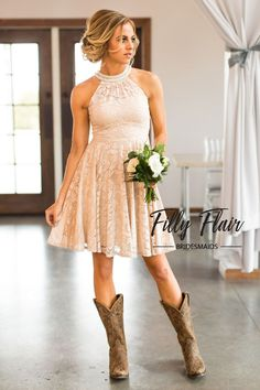 Fall head over heels with this beautiful lace bridesmaid dress! This stunning mid length dress features a gorgeous high pearled neckline and a classic a-line hem, giving you many different ways to sty