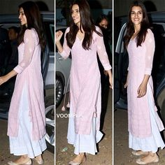 Kriti Sanon's simply stylish desi look is too adorable! The actress was clicked in a pink and white palazzo suit while visiting an orphanage recently. The trend of palazzo pants seems be growing with every season- so now such suits are definitely a wardrobe staple!
