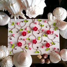 Paper quilling floral design  by artist Sayali Khedekar.