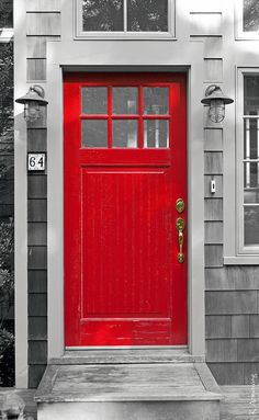A charming fire engine red front door