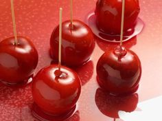 Candy Apples feature a layer of crunchy cinnamon hard candy that coats a crisp, tart apple.
