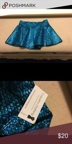 Coquetry clothing rave blue mermaid skirt NEVER WORN! Coquetry clothing rave blue mermaid skirt. Size medium. Super cute! Skirts Mini