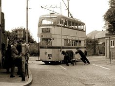 A Bournemouth Transport Corporation trolley bus being turned on a turning circle.