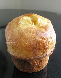 Popovers. Their name is almost onomatopoetic, isn't it? (Can't believe I spelled THAT one right on the first try!) I mean, when you put popovers into the oven, they look like calm, cream-colored lakes, serene as a summer sunrise. But 15 or 20 minutes later – POP! Up they go, the steam created by the &