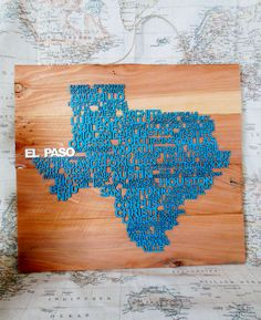 """Perfect gift for that Texas native in your life.  (Picture posted is a color example of finished product, in Teal with White.  Colors and highlighted city are completely customized.)  Texas cities laser cut into 1/16"""" Poplar wood, arranged in the shape ..."""