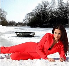 Dominique Hourani poses on the Snow in Lebanon with her Red outfit.