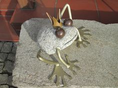 the frog made of gray granite and steel