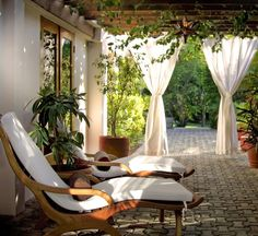Very inviting patio. Love the panels draping on one side; feels like home.
