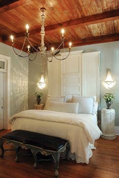 Add decorative molding to the top of doors or shutters to make a custom headboard.