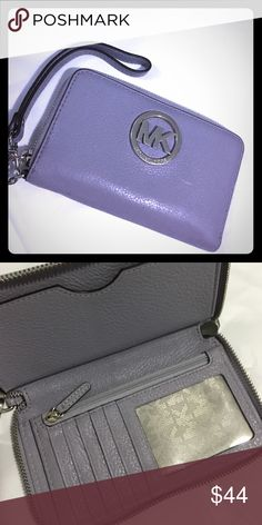 Michael Kors wallet It is the Fulton style in lavender. The MK symbol has a few scratches but overall it is In really good condition!! KORS Michael Kors Bags Wallets