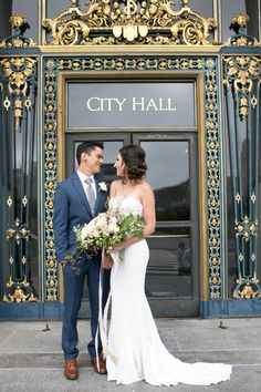 San Francisco City Hall - Intimate Wedding - elopement - courthouse wedding - navy blue and grey - strapless mermaid dress - messy side updo bridal hair - blush green and white bouquet - ribbon lace