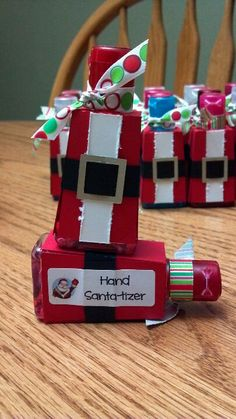 Hand Santa-tizer. Bath & Body Works hand sanitizer covered with a Santa suit made from  cardstock, tied off with a ribbon.