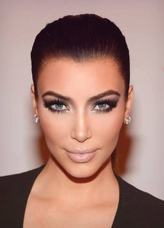 Kim kardashian. Love the blue eyes and this look on her