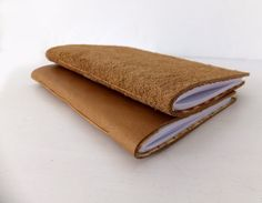 The covers of this Leather Notebook have been lined with a fabulous silky fabric to give it a luxurious feel - just like a fancy expensive suit! Hand sewn by peonyandthistle, £24.00