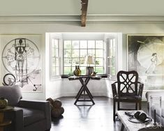 "Robert Rauschenberg prints and an 18th-century English chair in the Bridgehampton, New York, living room  of interior designer James ""Ford"" Huniford.   Pieter Estersohn  - ELLEDecor.com"