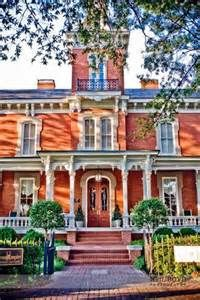 Historic mansion in downtown Raleigh, NC. French second empire architecture paired with a classic southern rocking chair front porch. Beautiful back drop for your ceremony or wedding portraits.Second Empire Restaurant Raleigh, NC. www.second-empire.com
