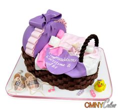 Purple and Pink Baby Carriage Cake This stunning carriage cake was made for the occasion of a baby shower and had to feed 50 people. We were delighted to be able to play with fun colors and different textures to make something really special and unique. The cake is a traditional carriage shape with no wheels. We made the base by inter-weaving dark brown fondant strips to give a ..... http://cmnycakes.com/gallery2/v/Cakes+For+All+Occasions/Purple+and+Pink+Baby+Carriage+Cake.html?