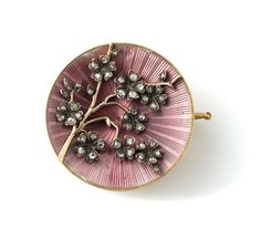 A brooch created by Faberge in 1899, depicting a Japanese cherry branch.