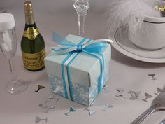 Vintage blue square wedding favour box, tied with blue and ivory ribbon