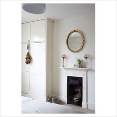 fireplace and built-in wardrobe in bedroom (Gap Interiors)