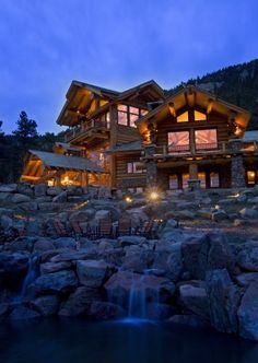 Log cabin in the mountains by water would be heaven on earth.  A beautiful gift from God. (side note: Log homes are a pain to take care of. They're beautiful, but after living in one, watching my parents stain, strip, stain, and wash the logs, I would never live in one.)