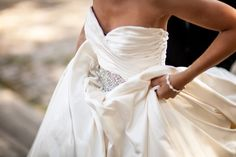 the bride said this satin gown (with pockets) felt like butter on her skin.