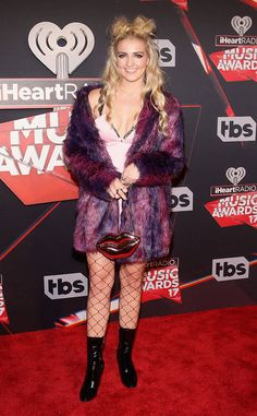 Rydel Lynch from iHeartRadio Music Awards 2017: Red Carpet Arrivals All eyes were on this pop singer as she arrived in a multi-colored fur coat and fishnet stockings.