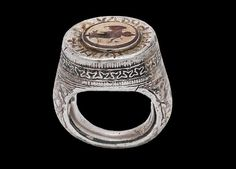 Medieval Serbian massive silver ring with ancient gemstone cameo. Ring is from the 14th century AD and cameo from the 4th century BC. As per inscription of the top of the ring it belonged to nobleman Radul.