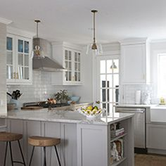 All white with Marble Counters...glass cabinets and side bookcase.