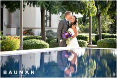 Sweet reflection in the water at this USD Founders Chapel Wedding, Photography by Bauman Photographers  View More:  http://baumanphotographers.com/blog/uncategorized/2015/11/darlington-house-wedding/